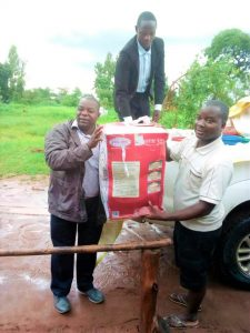 Picture of Fr Bulambo (left) presenting some of the gifts to Fr Petros Mwale