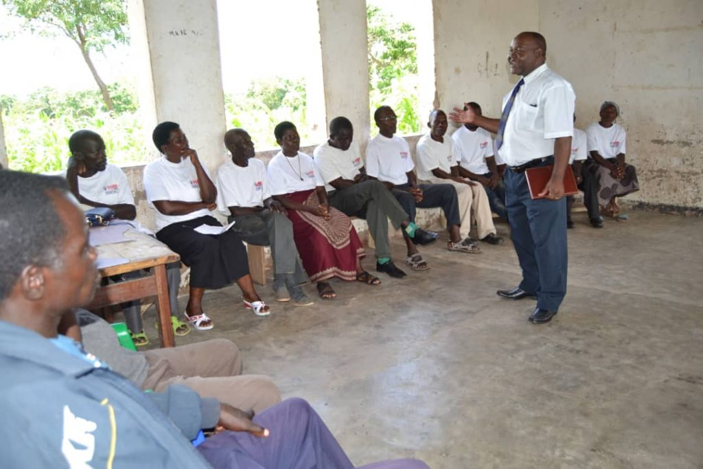 Picture of Karonga District Commissioner instructing CBEs on Gender Based Violence