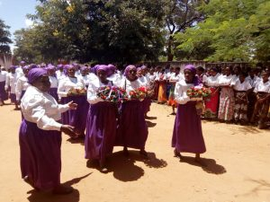 Picture of Catholic Women Organisation members carrying flowers and wreaths