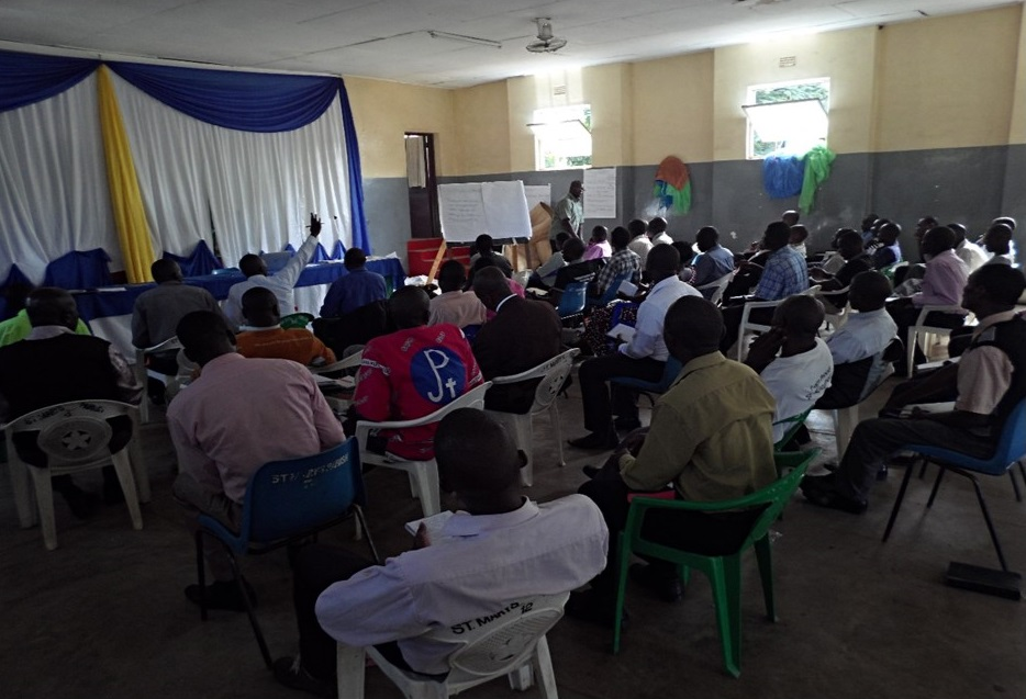 Picture of Fr. Joseph Sikwese, Pastoral Secretary of the Diocese, facilitating during the training at St Mary's Parish