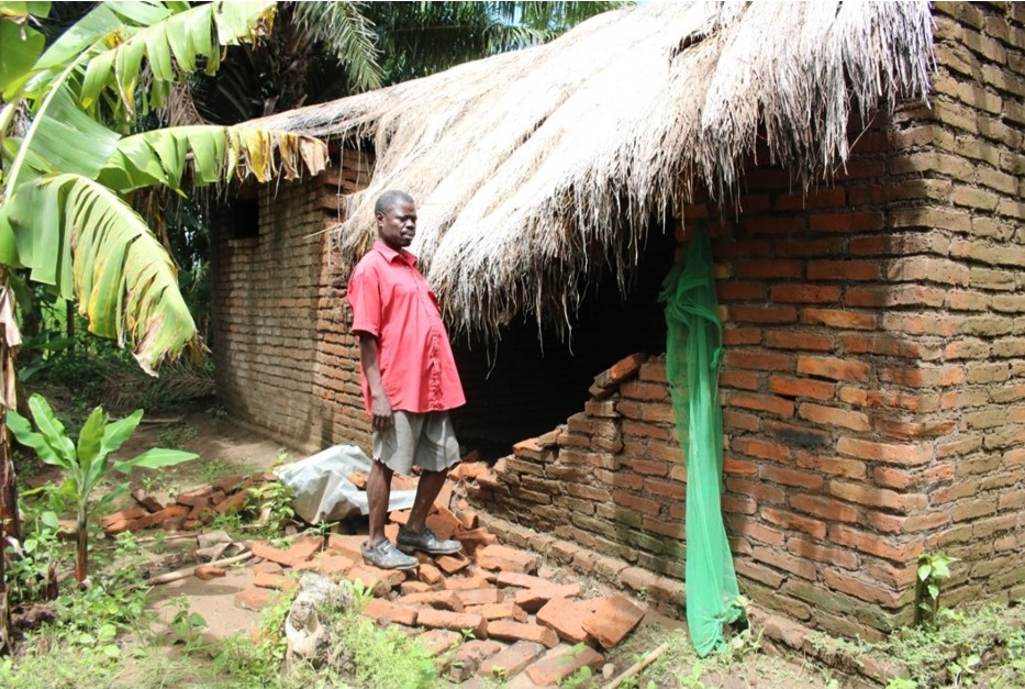 Picture of Figure 3: A flood victim in Mangulu Village whose house is damaged