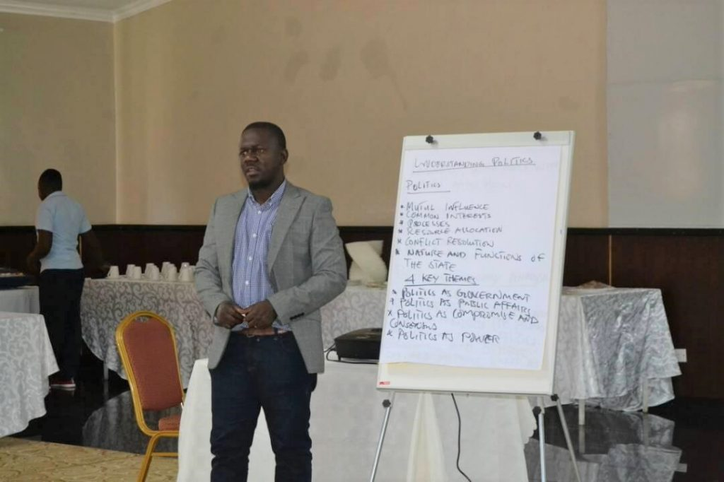 Justice and Peace Desk Officer, Louis Nkhata, facilitating during the workshop