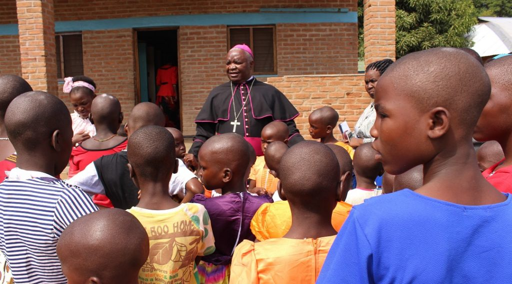 Bishop Mtumbuka interacts with children under the Lusubilo Orphan Care