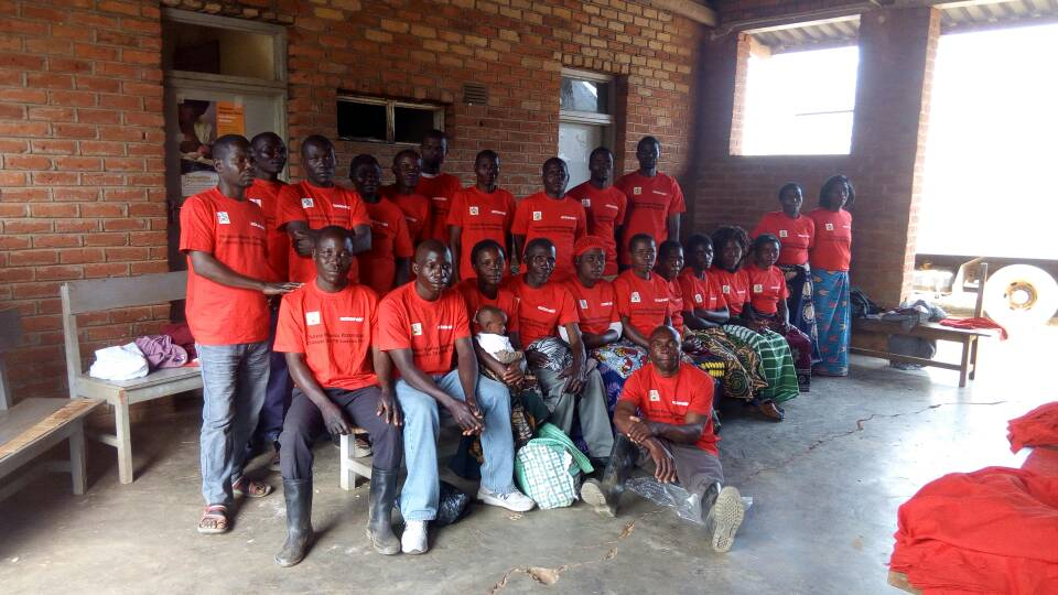 Community TB Volunteers putting on t-shirts as part of their identity