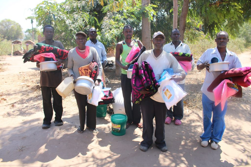 Village Headman Mwankenja (far right) with his subjects after the distribution exercise