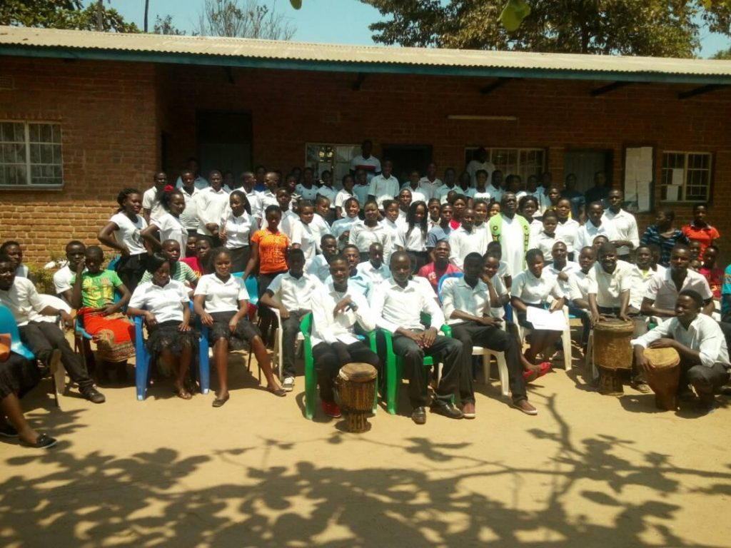Father Mwale and the youth rally participants