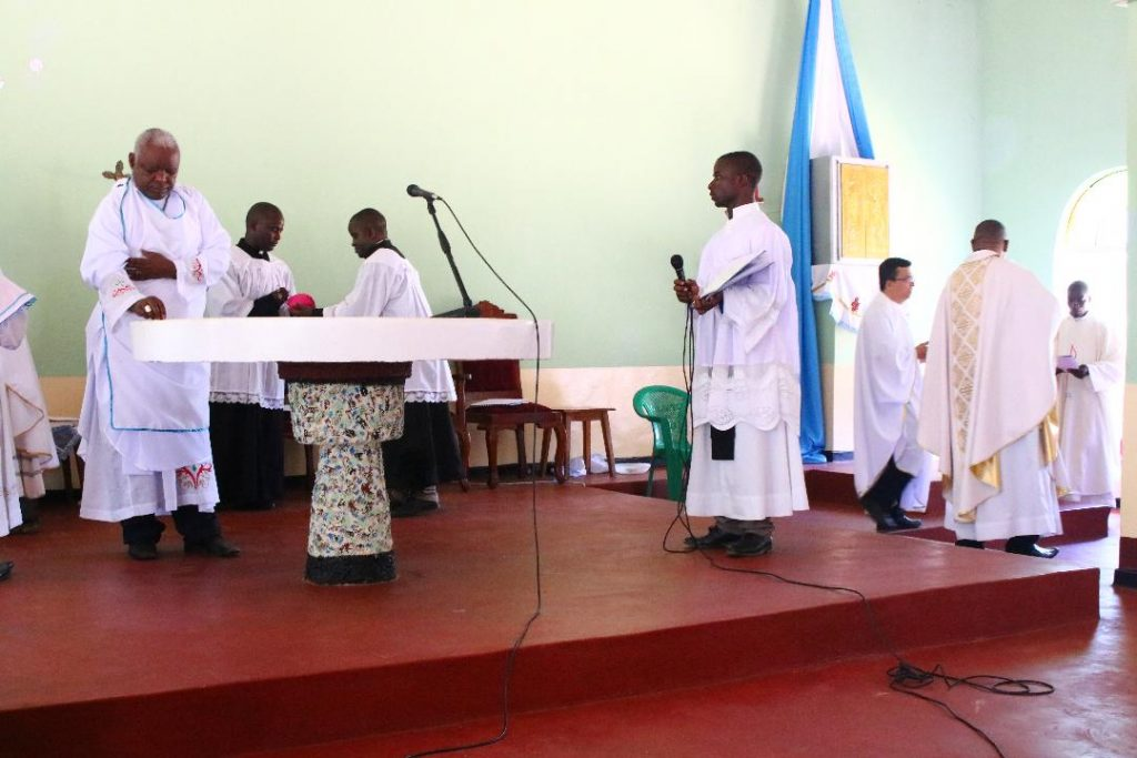 Bishop Mtumbuka consecrating the altar with Holy Oils