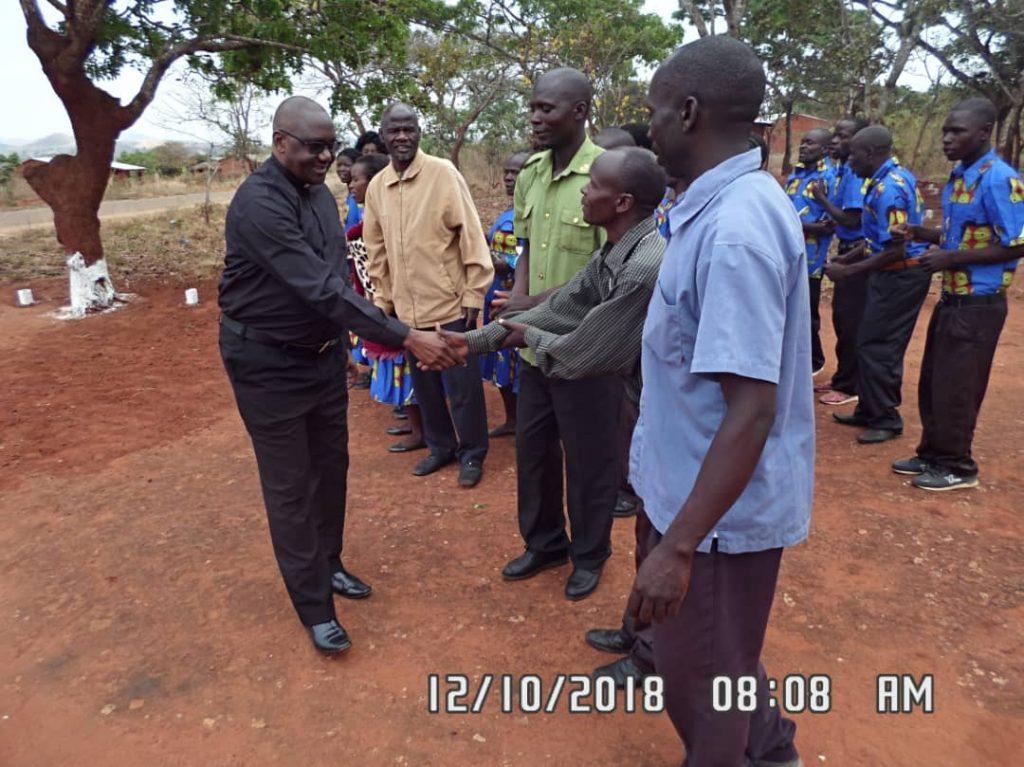 Vicar General greeting Church leaders upon arrival at Wenya