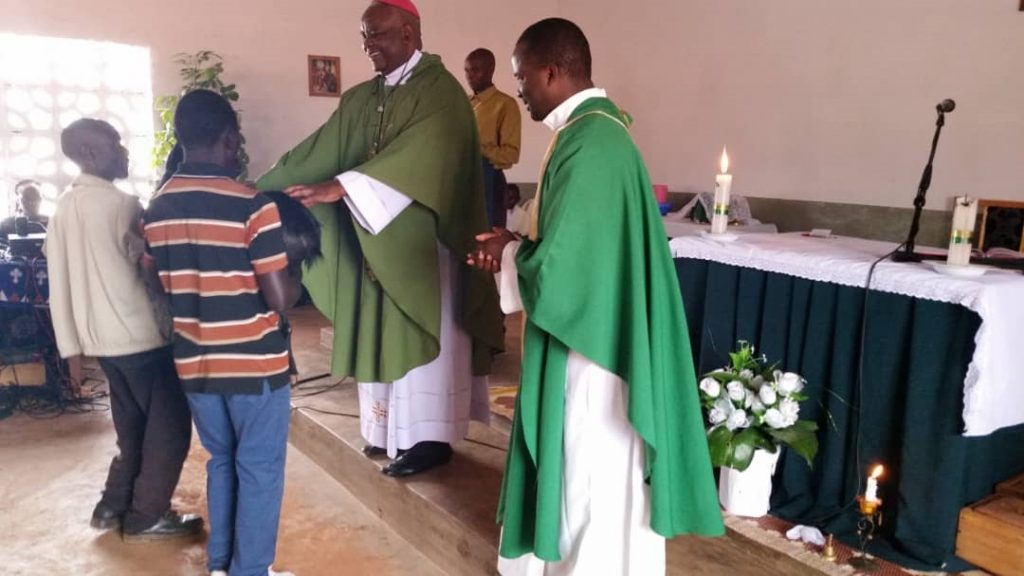 Bishop Mtumbuka receiving gifts during the celebration at Chiwanji