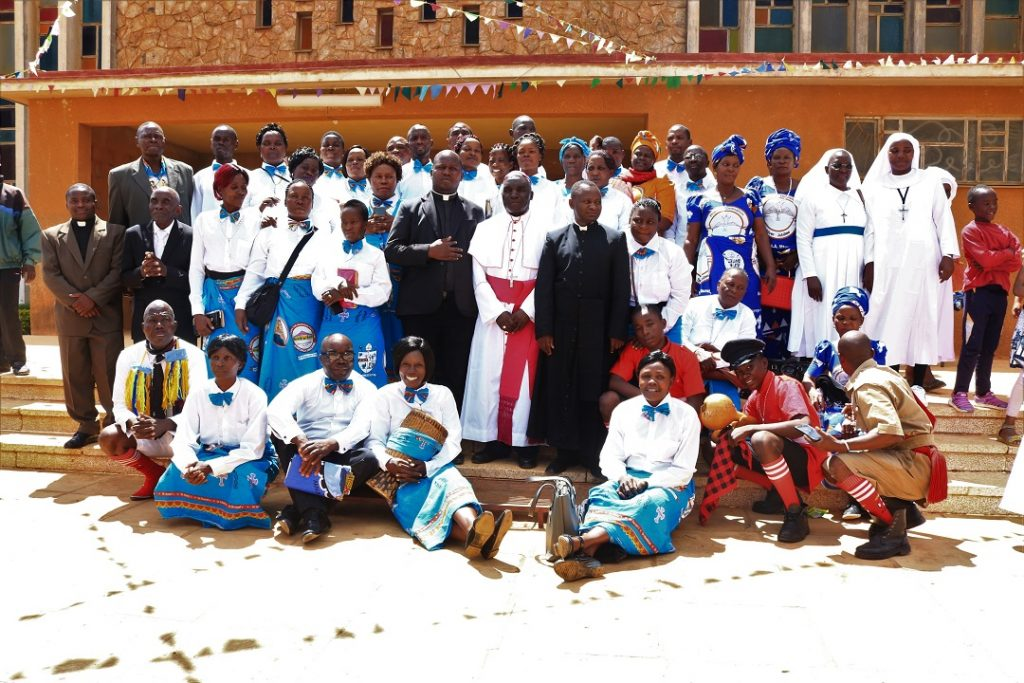 Members of Tuntufye Choir pose for a photo with Bishop Maluma