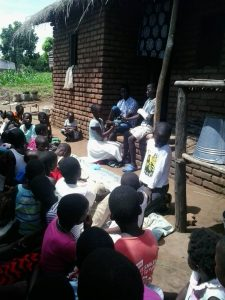 Get well soon: A representative of the Sunday school children presenting something to Misheck