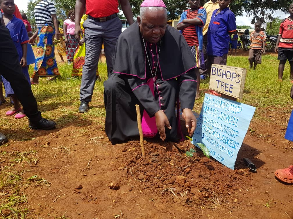 The Bishop planting his tree at the school during the Launch