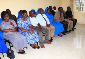 8 members of the Review Board on Protection of Minors and Vulnerable Adults (front row) during the swearing in ceremony