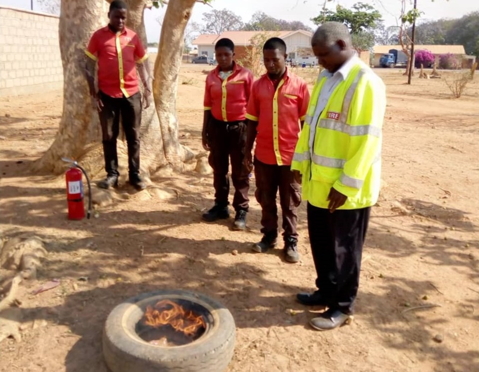 Joseph Malele setting an old tyre on fire for demonstration on the day