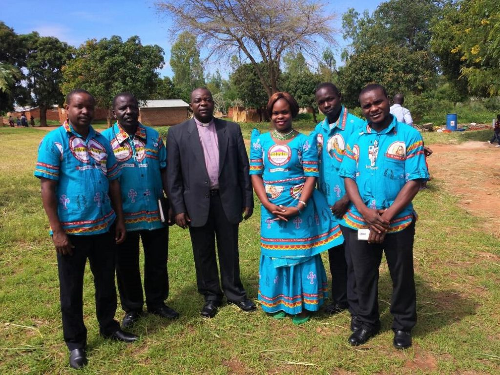 Picture of Karonga Diocese led by Fr Steven Bulambo in suit