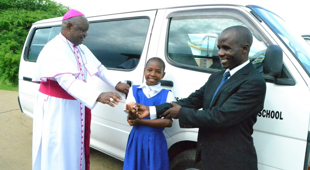 Picture of Bishop Mtumbuka hands over keys to the Mr Ngwira and a student representative