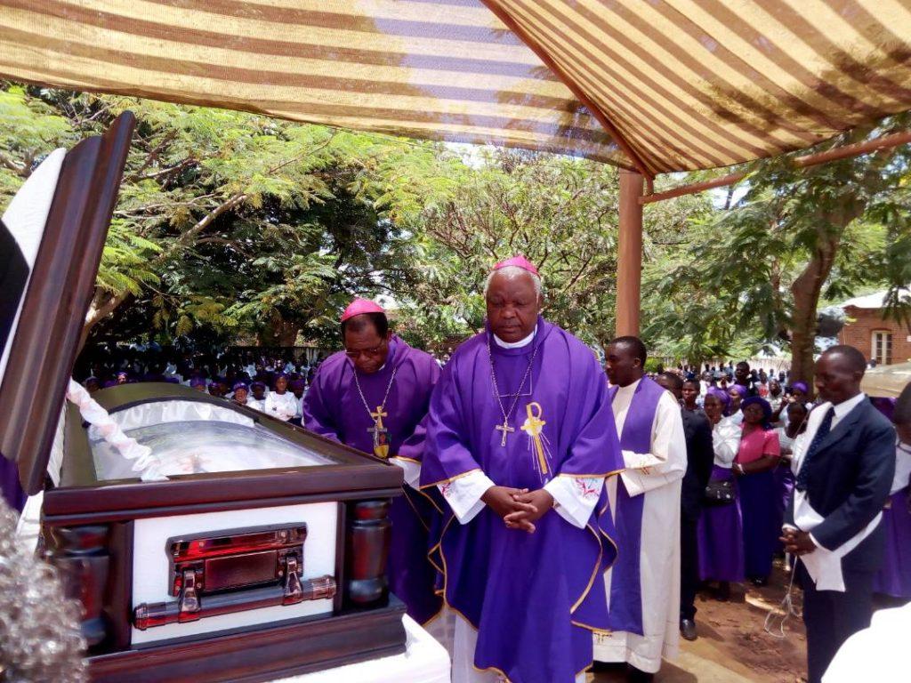Picture of Bishop Mtumbuka (in front) and Archbishop Ziyaye (behind) file past the body of Bishop Kanyama