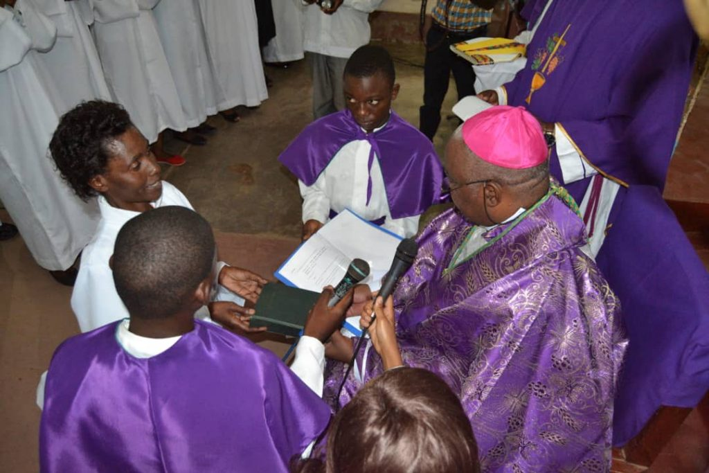 Picture of Bishop Mtumbuka installing one of the candidates