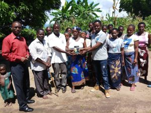 Picture of Ephraim Nyirenda (far right) with members of Radio Listening Club in Chilumba a day before he passed on