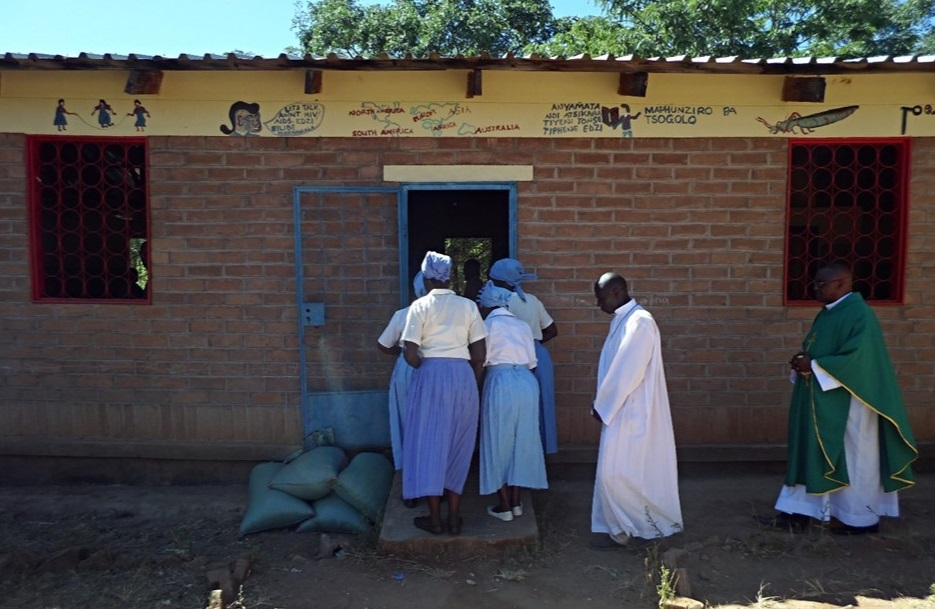 The Vicar General on a procession at the beginning of Mass; allowed to celebrate mass in a classroom block at Juma CCAP Primary School since the Catholic community has no proper Church building