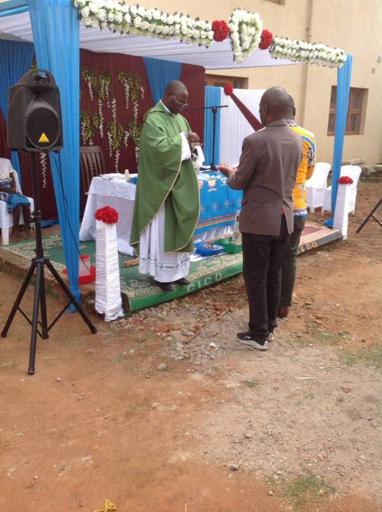 Father Joseph Sikwese distributing Holy Communion