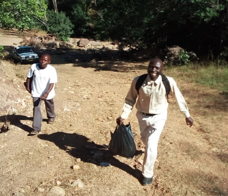 The walk to Juma begins, leaving the vehicle stuck in deep sand in one of the running streams