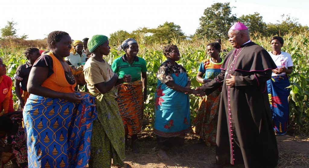 Touching lives: Bishop Mtumbuka interacts with beneficiaries of SORT project