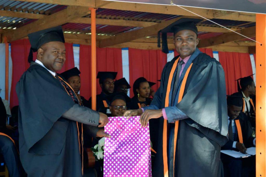 Mr Richard Hara (R) receives a token of appreciation from Bro Mfune