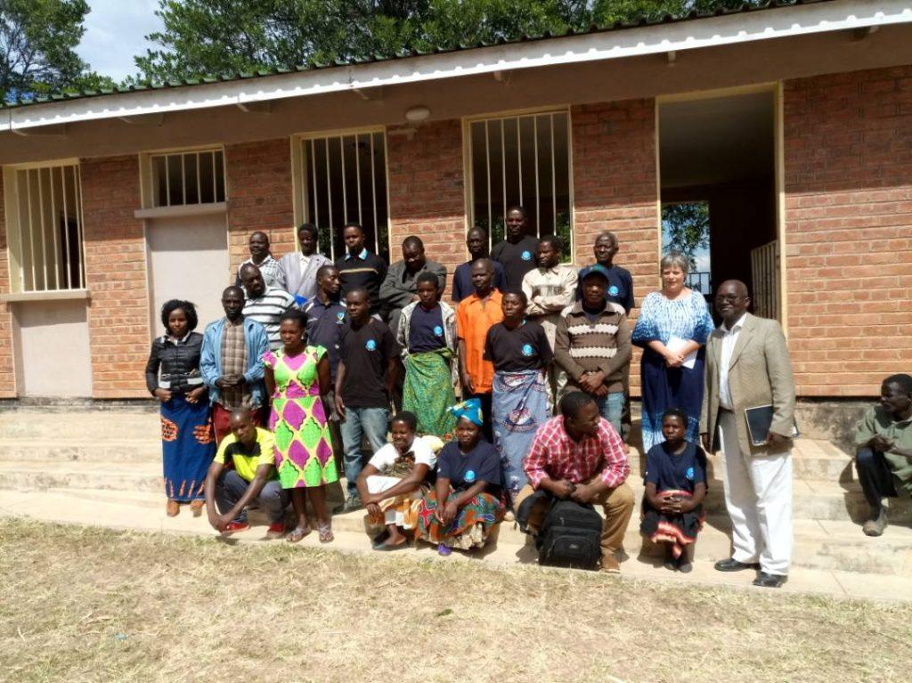 Ellen with CCJP volunteers and project beneficiaries