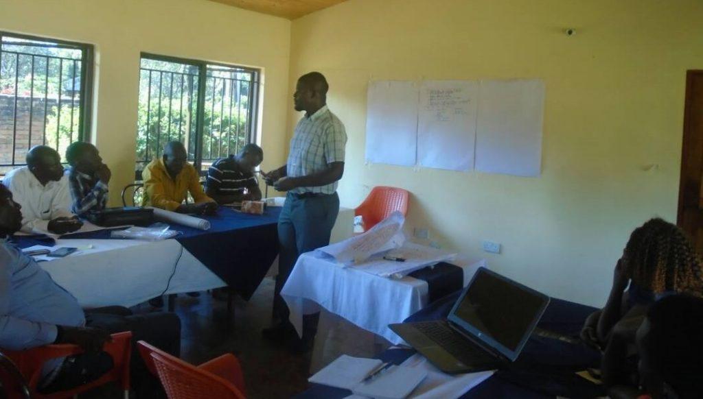 Caritas Secretary Mr Mwawi Shaba engaging participants during the training