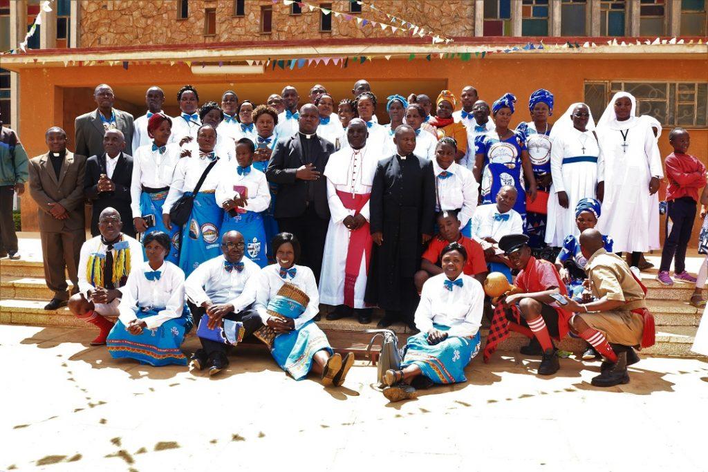 Members of Tuntufye Choir pose for a photo with Bishop Maluma