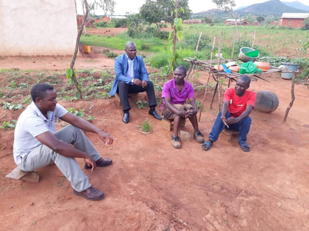 From left to right: Mr Vincent Shaba (Health Desk Officer), Father Edward Kamanga, Patrick Msukwa and TB Volunteer during a monitoring visit