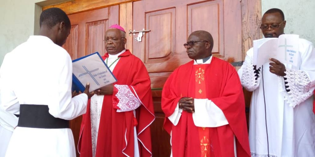Bishop Mtumbuka offers a prayer before opening the doors of the new church