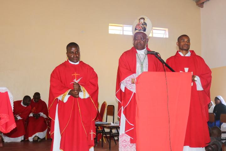Bishop Mtumbuka (Centre) with the new parish priest for the parish (Father Simwela - left) and Curate Father Mwafulirwa
