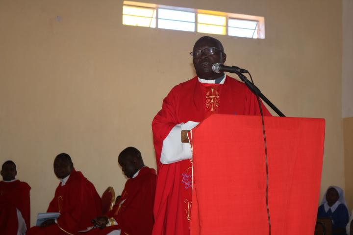 Father John Benjamin Moyo speaking during the function