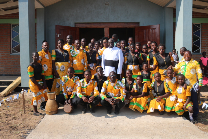 Father Moyo with choir members after Mass