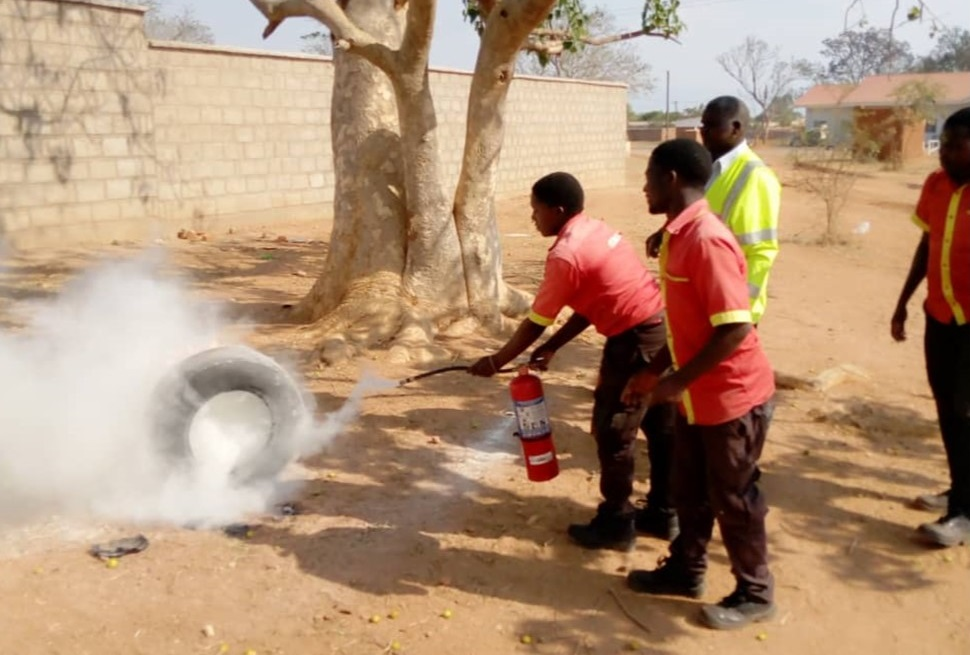 Fire put out using handheld fire extinguisher during demonstrations