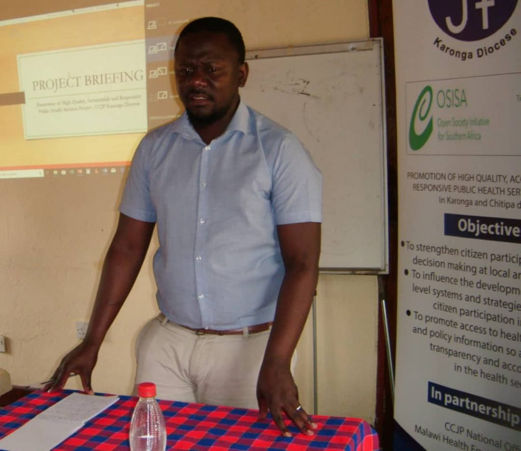 Nkhata giving a brief background of the project. Picture by Jordan Simeon-Phiri