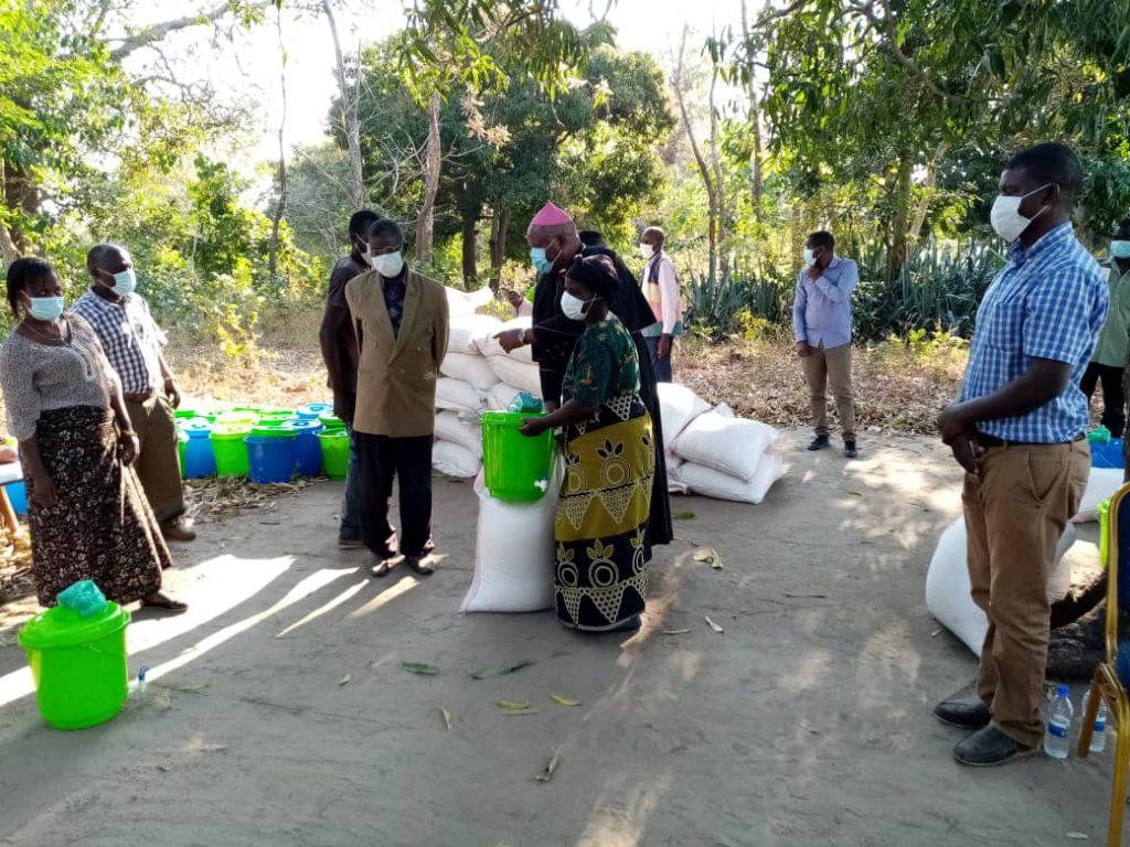 Bishop Martin Mtumbuka distributing relief items