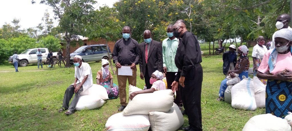 Mons. Chitete (in black facemask) with some of the beneficiaries