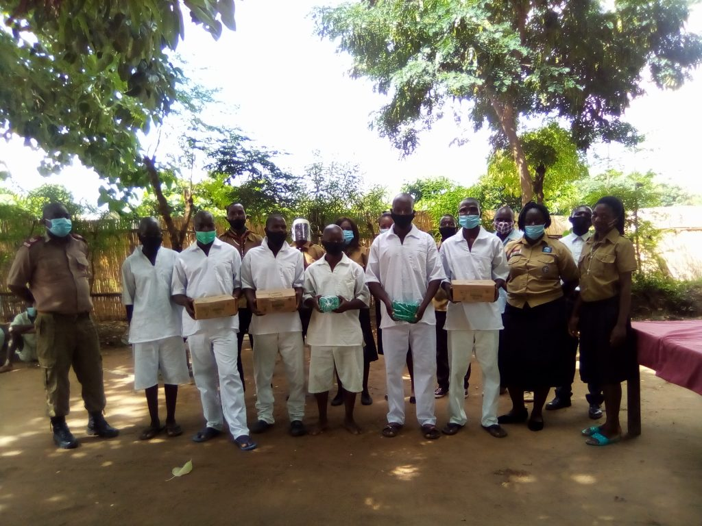 Scouts members with some of the inmates at Karonga Diocese